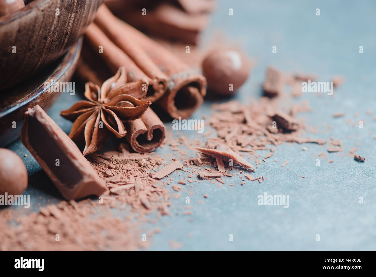 Header with chocolate pieces, spices, anise stars, cinnamon and cocoa on a stone background. Cooking desserts and - Stock Image