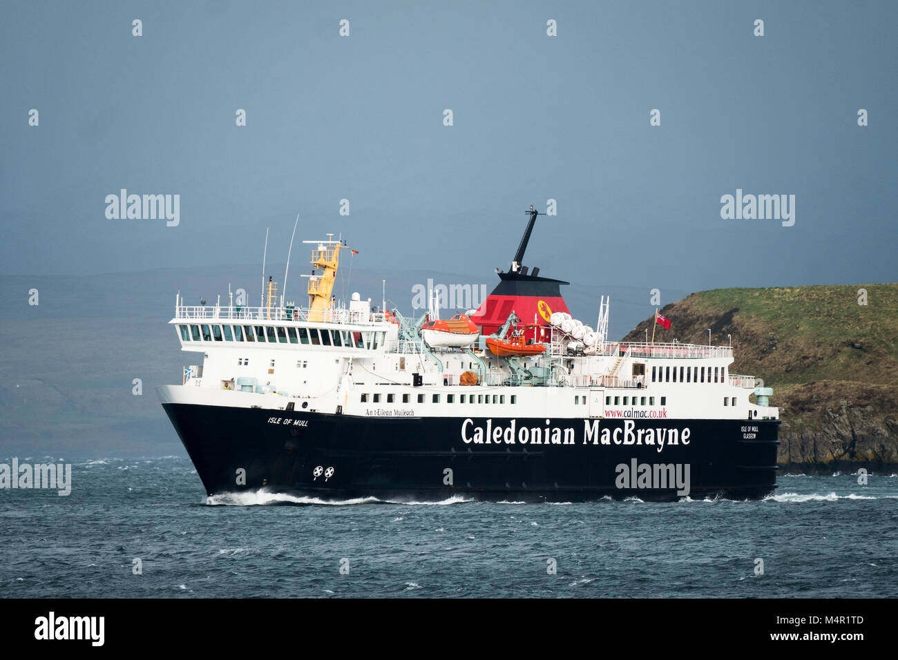 The Caledonian MacBrayne ferry the Isle of Mull sails into Oban Harbour on its return journey from Craignure, on - Stock Image
