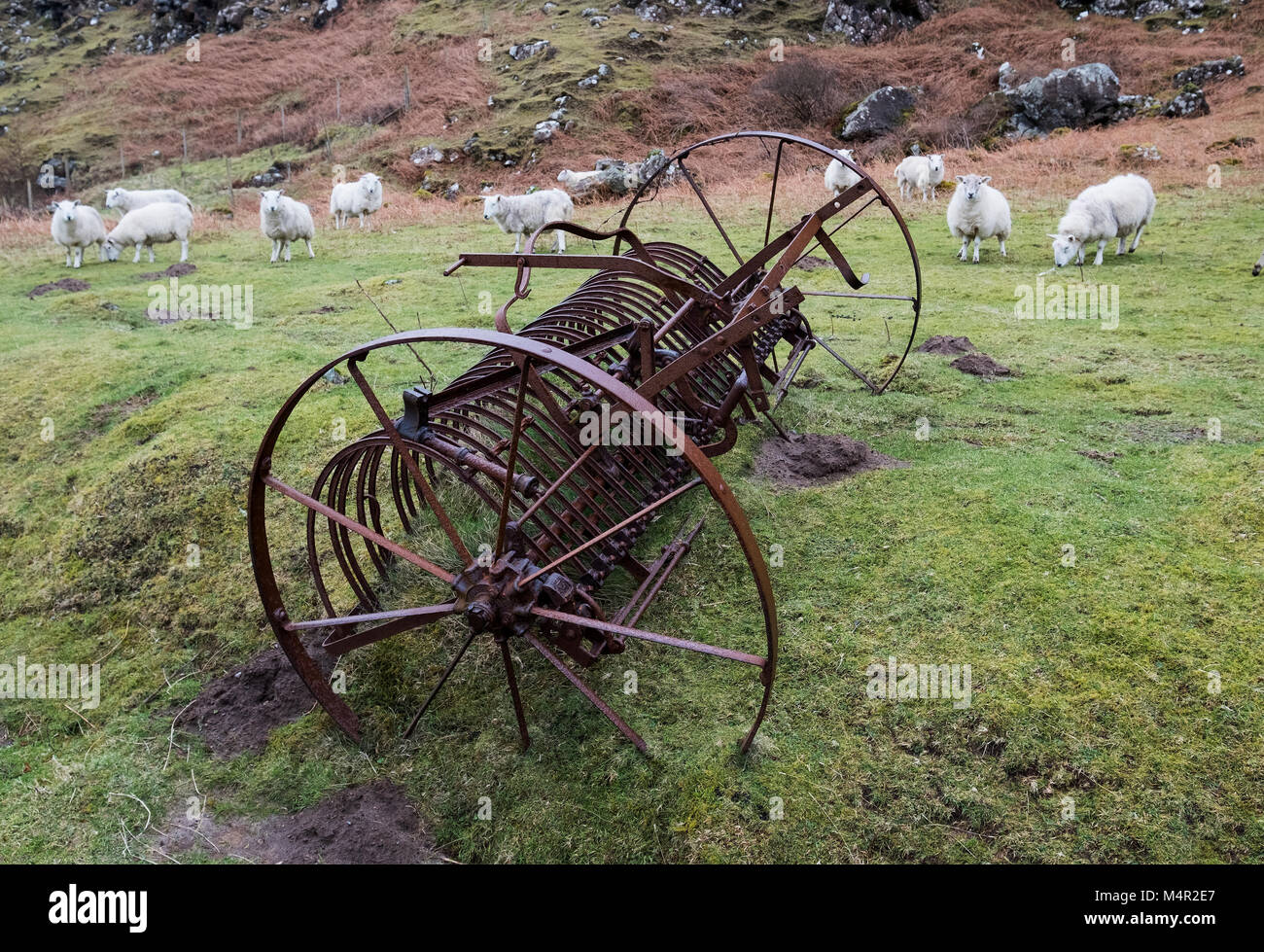 Abandoned agricultural haymaking machine on the Isle of Mull, Inner Hebrides, Scotland. - Stock Image