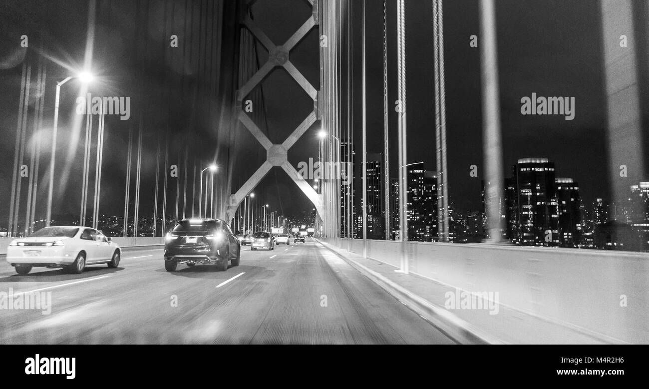 Black and white photography of the Golden Gate Bridge by night, San Francisco, California - Stock Image