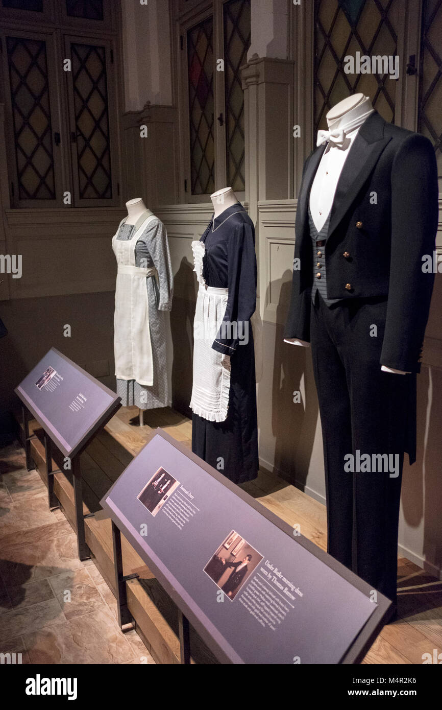 The costumes worn by the servants as seen at at Downton Abbey The Exhibition on West 57th Street in Midtown Manhattan, - Stock Image