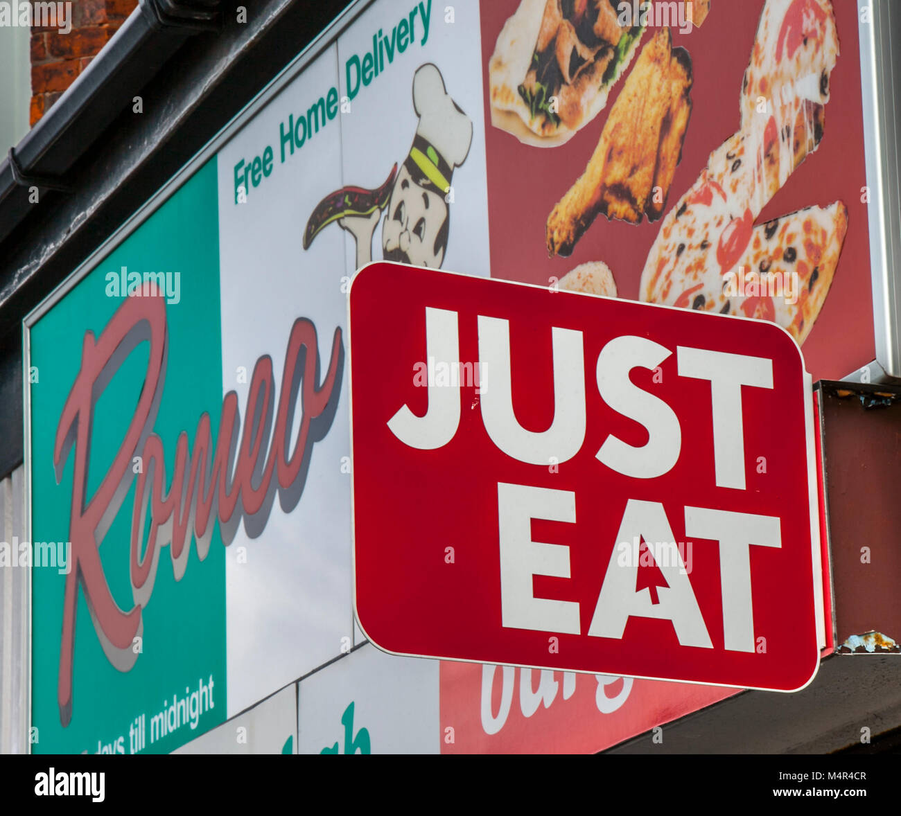 Just Eat advertising sign on front of pizza restaurant, Southport, UK - Stock Image