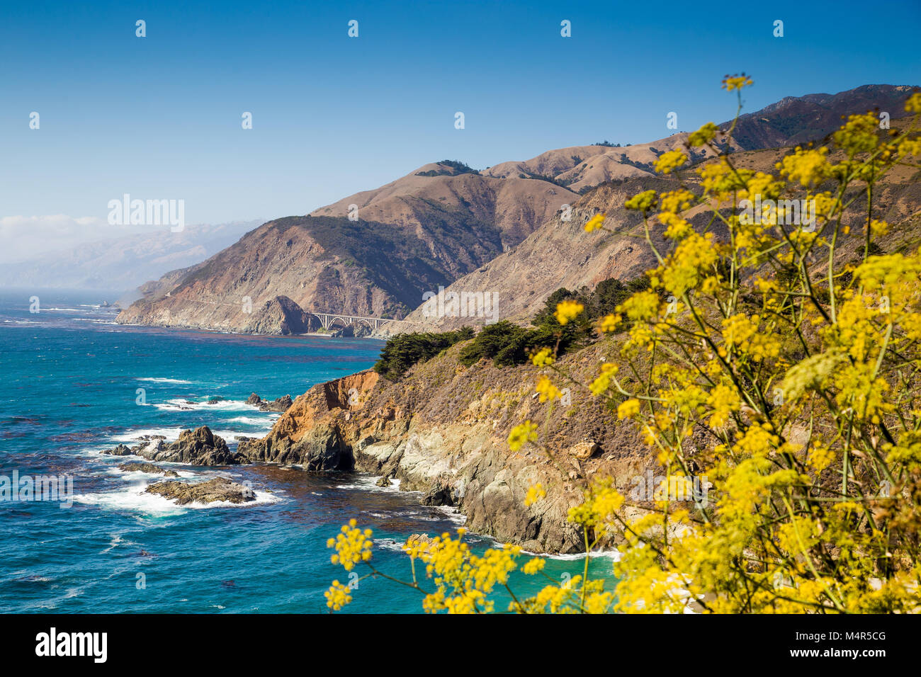 Scenic view of the rugged coastline of Big Sur with Santa Lucia Mountains and Big Creek Bridge along famous Highway Stock Photo