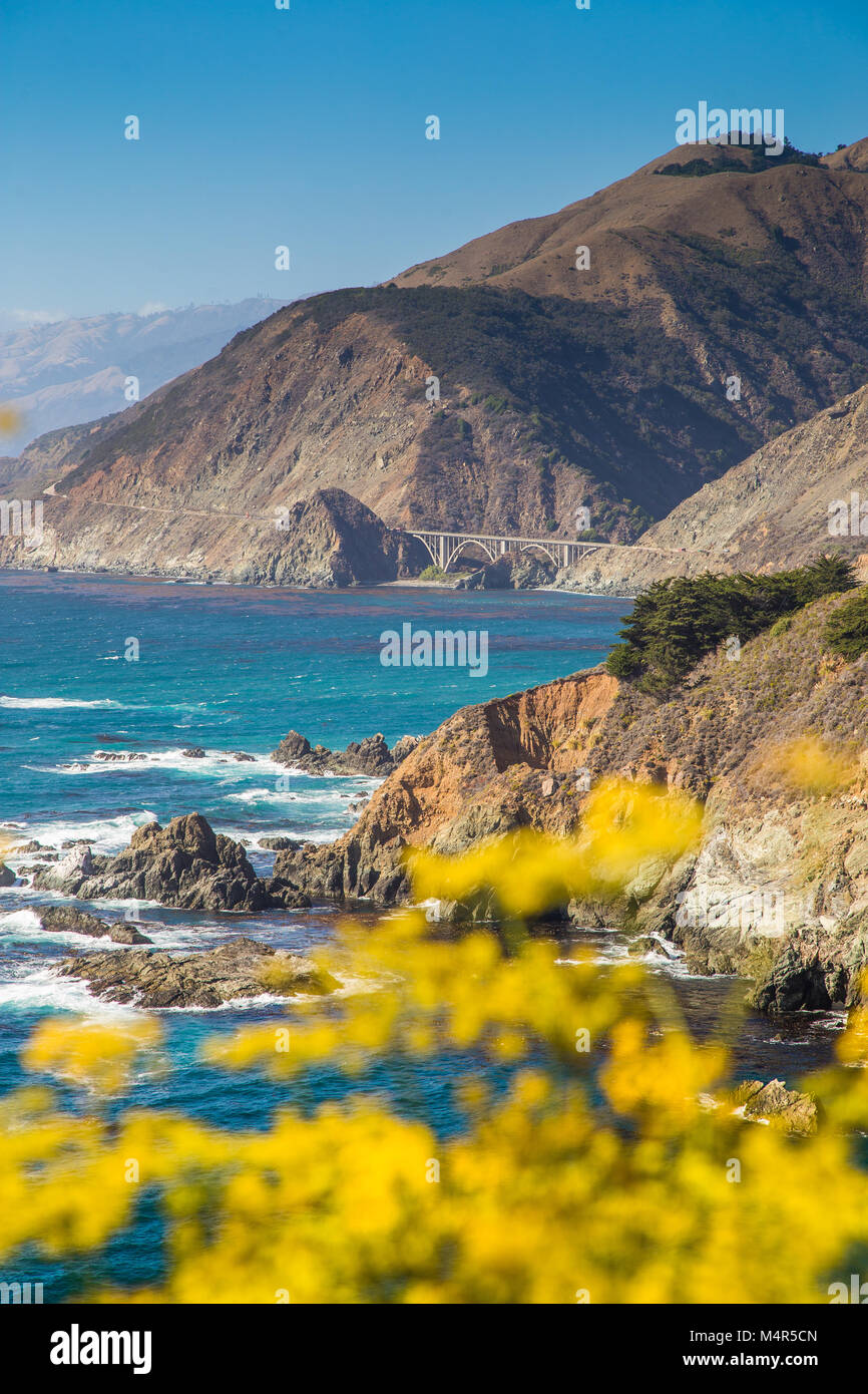 Scenic view of the rugged coastline of Big Sur with Santa Lucia Mountains and Big Creek Bridge along famous Highway - Stock Image