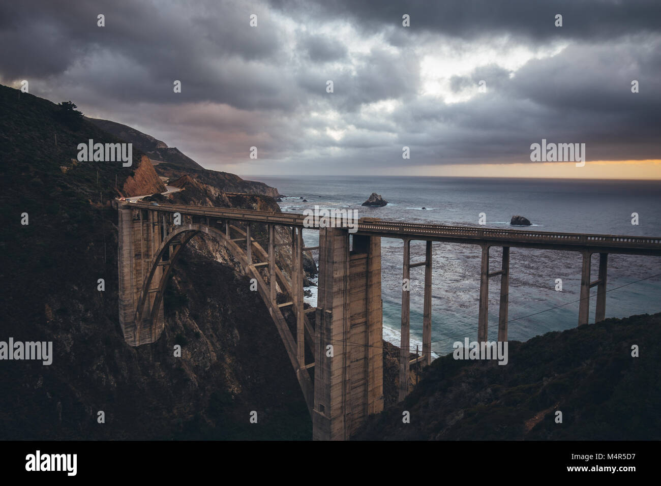 Scenic panoramic view of historic Bixby Creek Bridge along world famous Highway 1 in beautiful evening twilight, - Stock Image