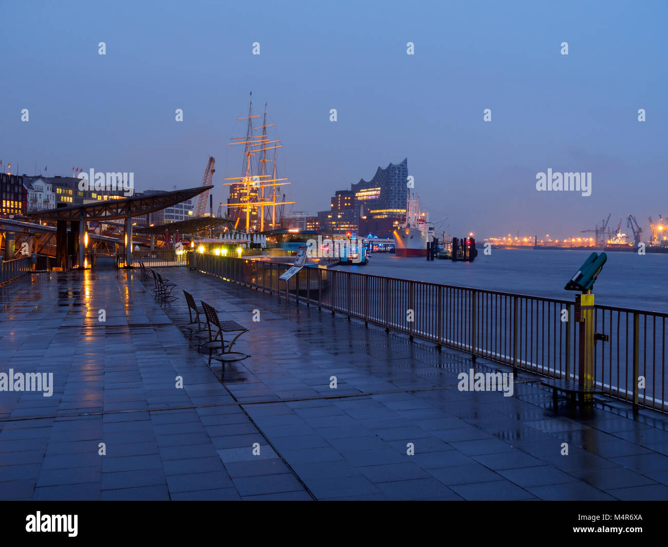 Hamburg, Germany - April 04, 2016: Deserted port of Hamburg at rainy day in the evening with Elbphilharmonie and Stock Photo