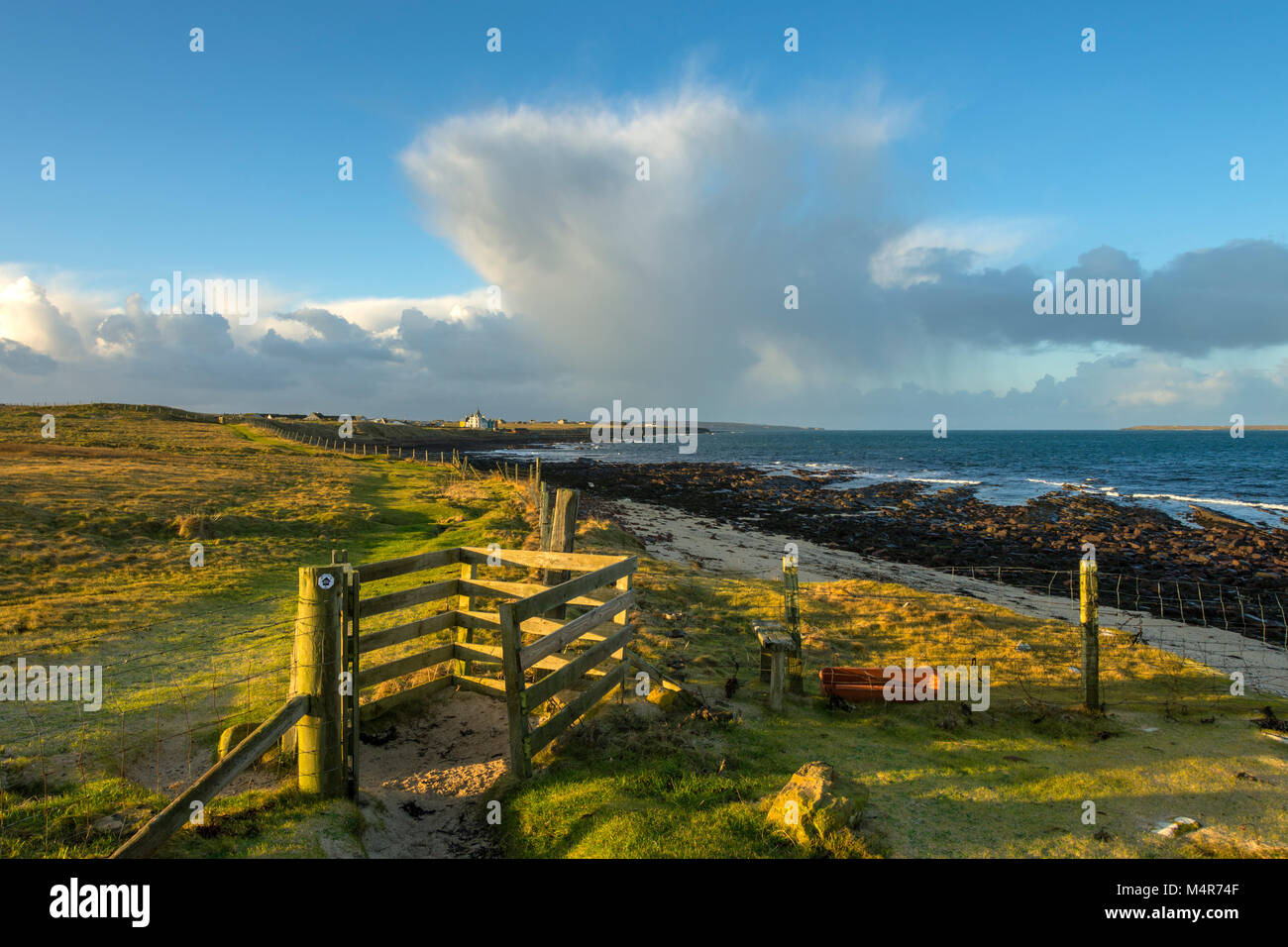 A stile on the coastal path between John o'Groats and Duncansby Head, Caithness, Scotland, UK - Stock Image