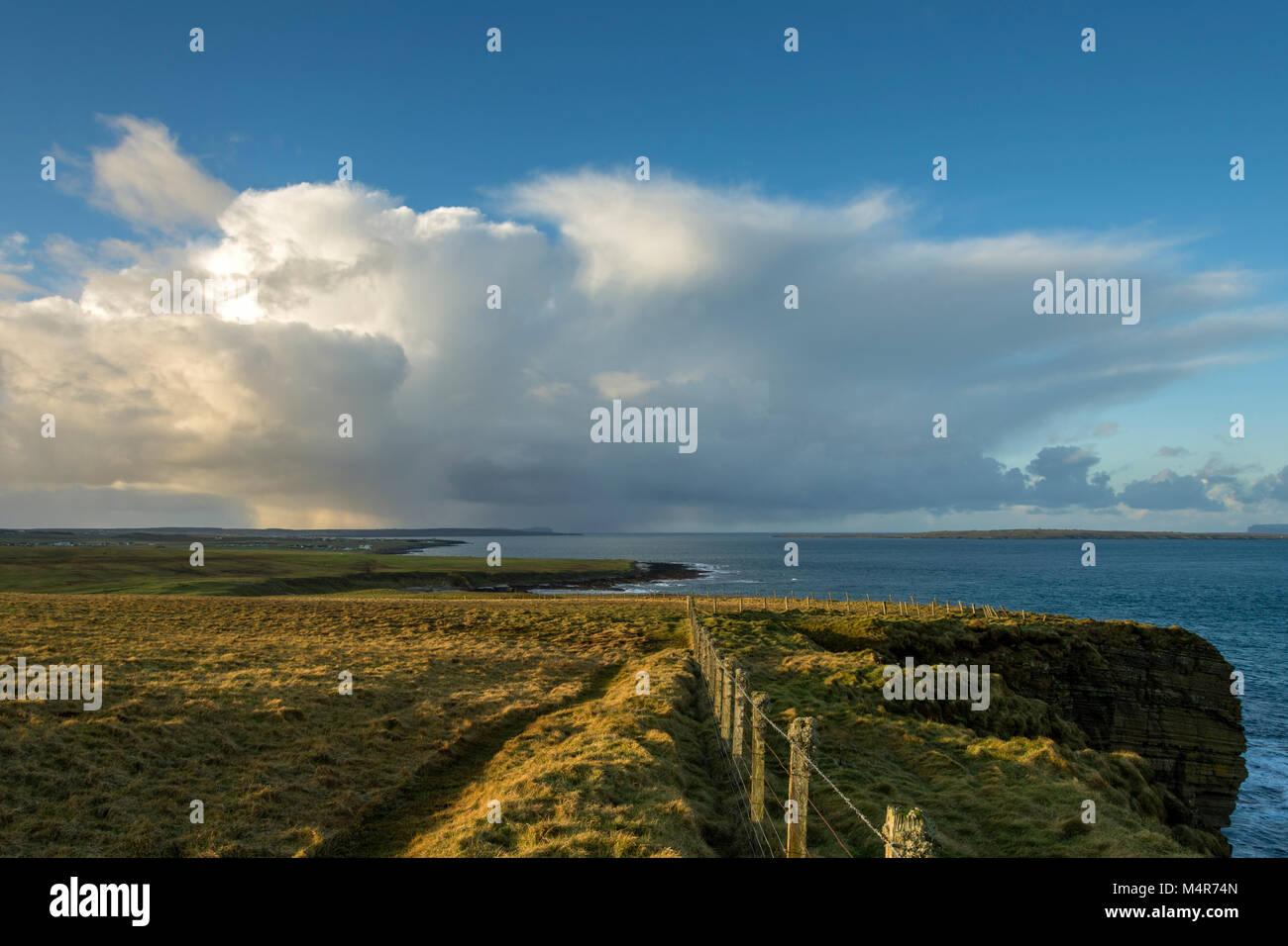 Cumulonimbus cloud over Dunnet Head, from Duncansby Head, near John o'Groats, Caithness, Scotland, UK - Stock Image