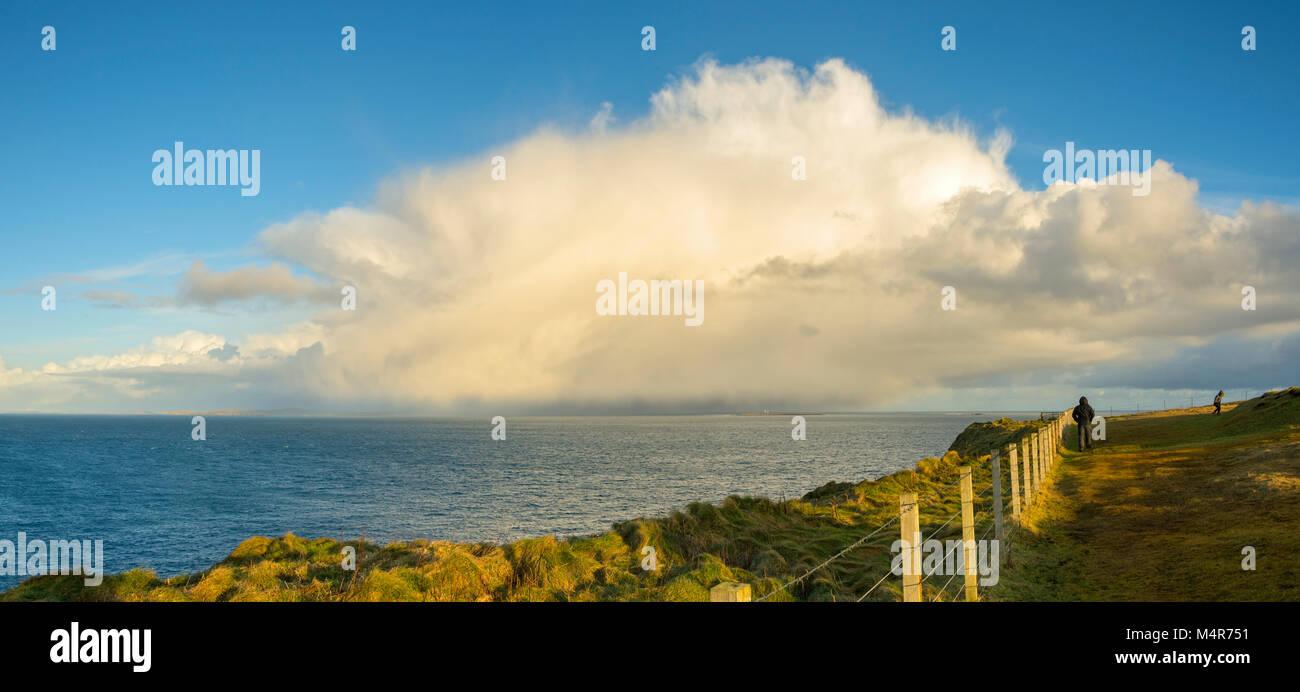 A cumulonimbus shower cloud off Duncansby Head, near John o'Groats, Caithness, Scotland, UK. - Stock Image