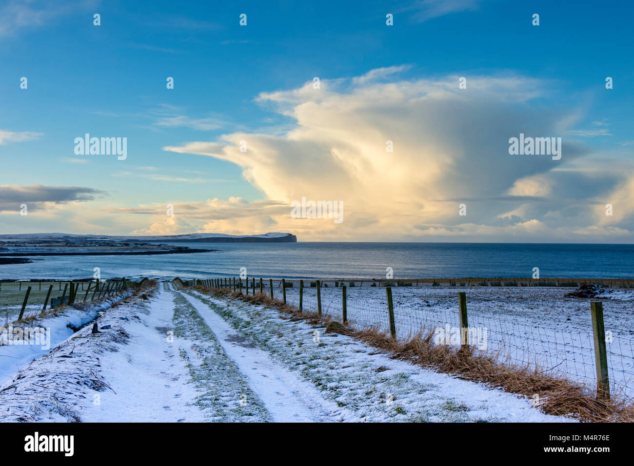 Cumulonimbus cloud over Dunnet Head and the Pentland Firth, from Long Geo Farm, near the village of Mey, Caithness, - Stock Image