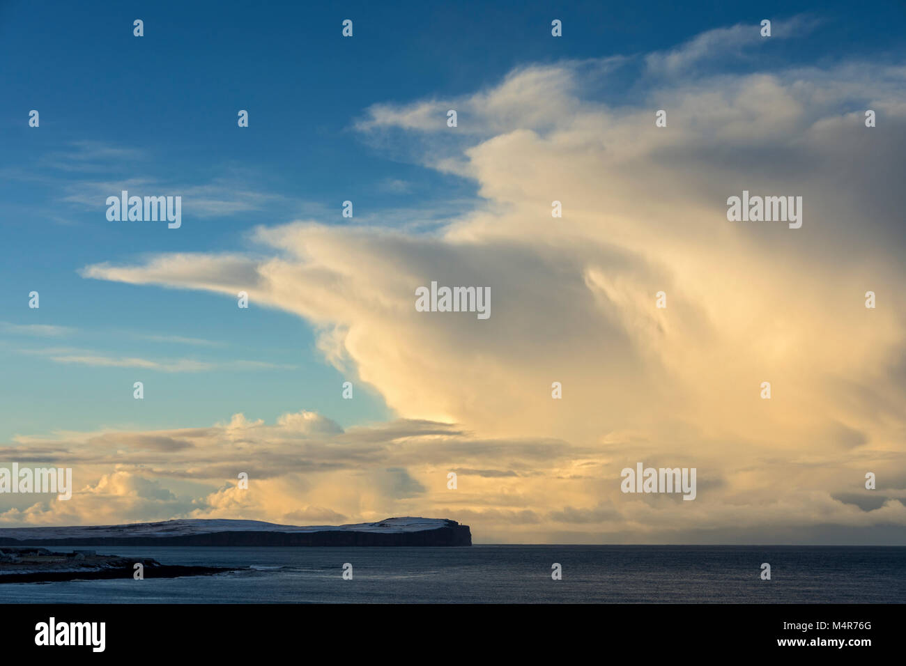 Cumulonimbus cloud over Dunnet Head and the Pentland Firth, from near the village of Mey, Caithness, Scotland, UK - Stock Image