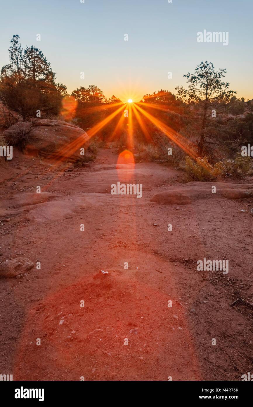 Sunburst straight ahead seen from rocky trail. Garden of the Gods, Colorado. Stock Photo