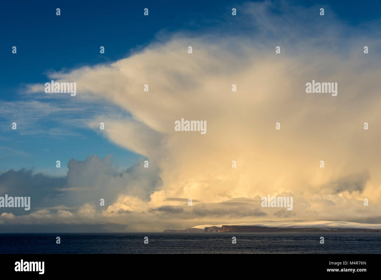 Cumulonimbus cloud over the island of Hoy, Orkney Isles, and the Pentland Firth, from near the village of Mey, Caithness, - Stock Image