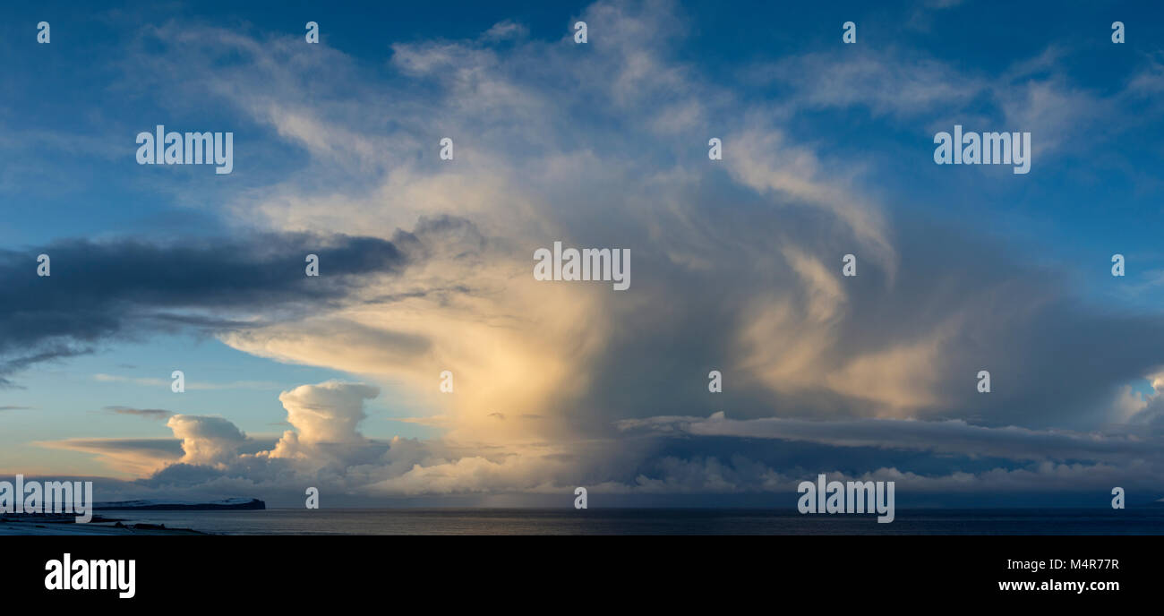 Cumulonimbus cloud over the island of Hoy, Orkney Isles, over the Pentland Firth, from near Mey, Caithness, Scotland, - Stock Image