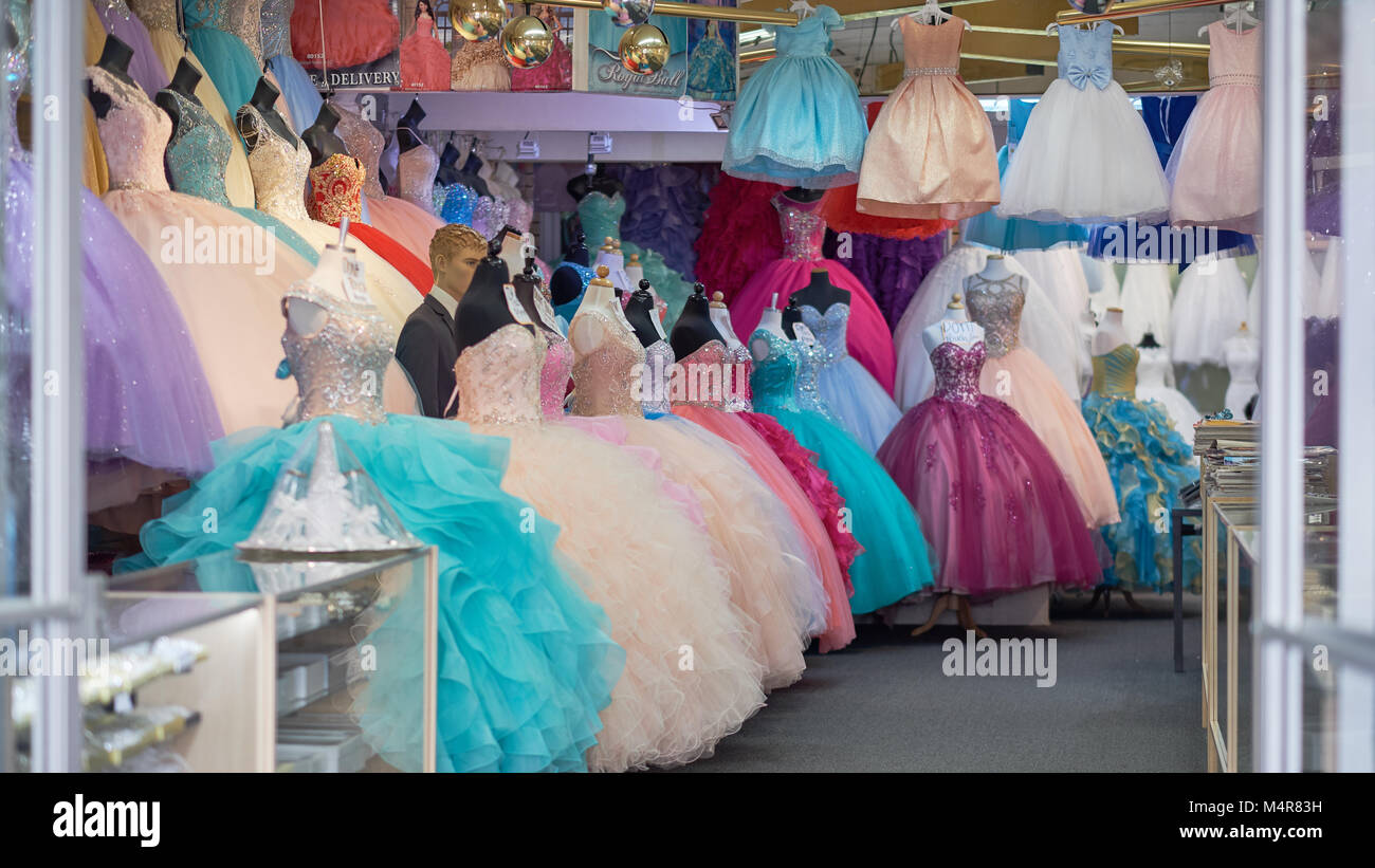 Dress Shop Selling colorful gowns - Stock Image