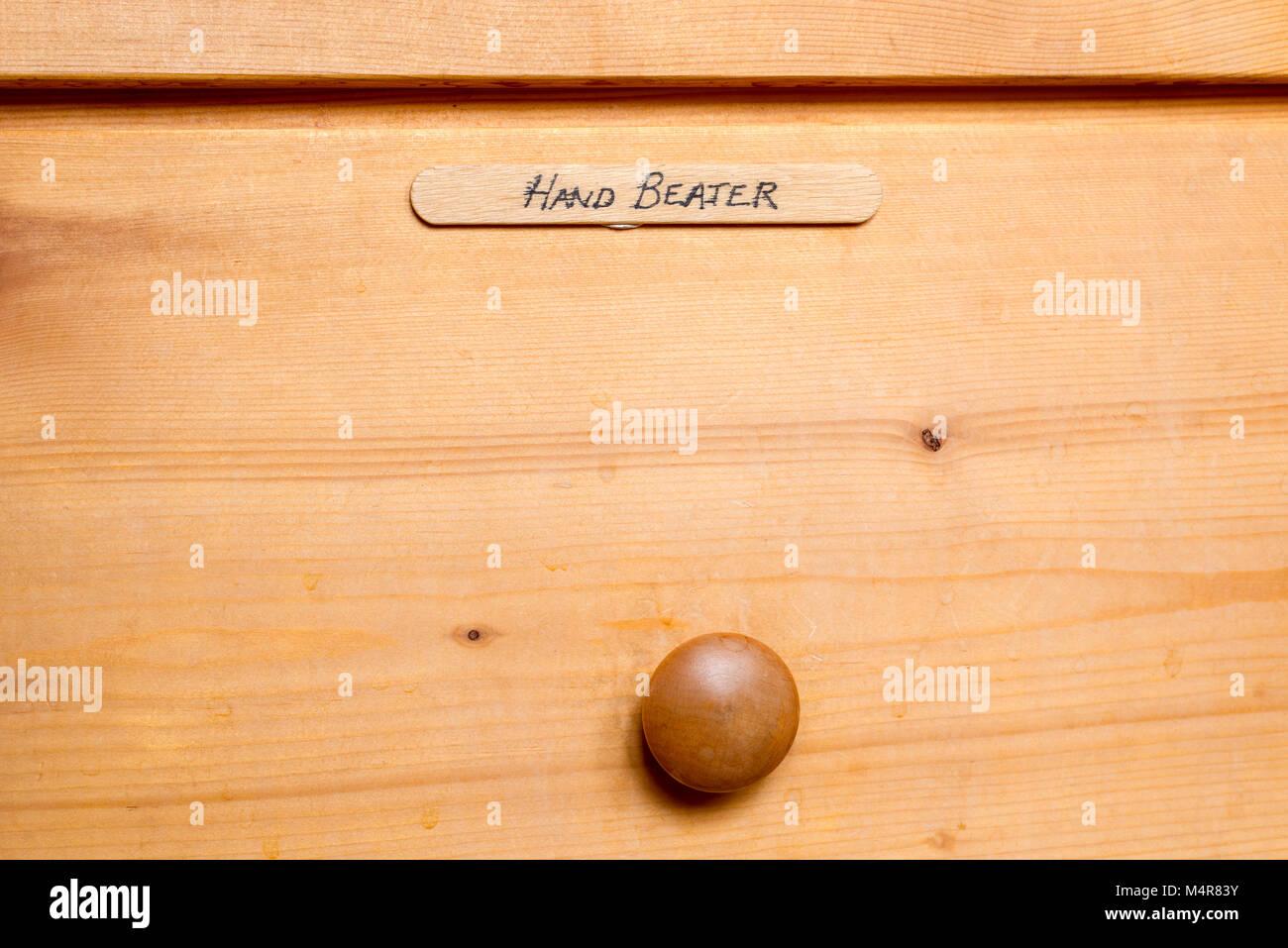 Kitchen drawer with tounge depressor label. - Stock Image