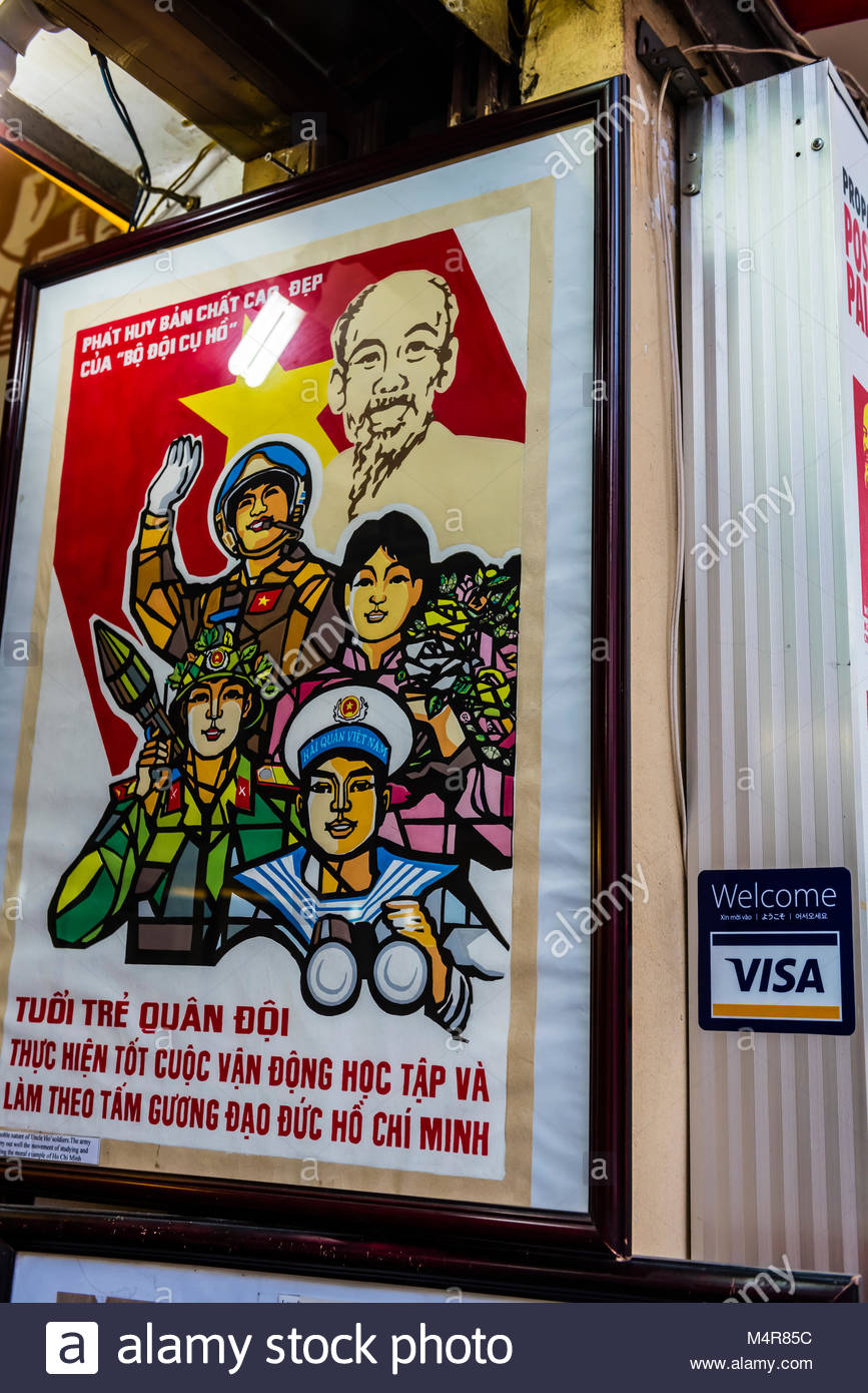 A North Vietnamese war propaganda poster in a shop, Hanoi, northern Vietnam. - Stock Image