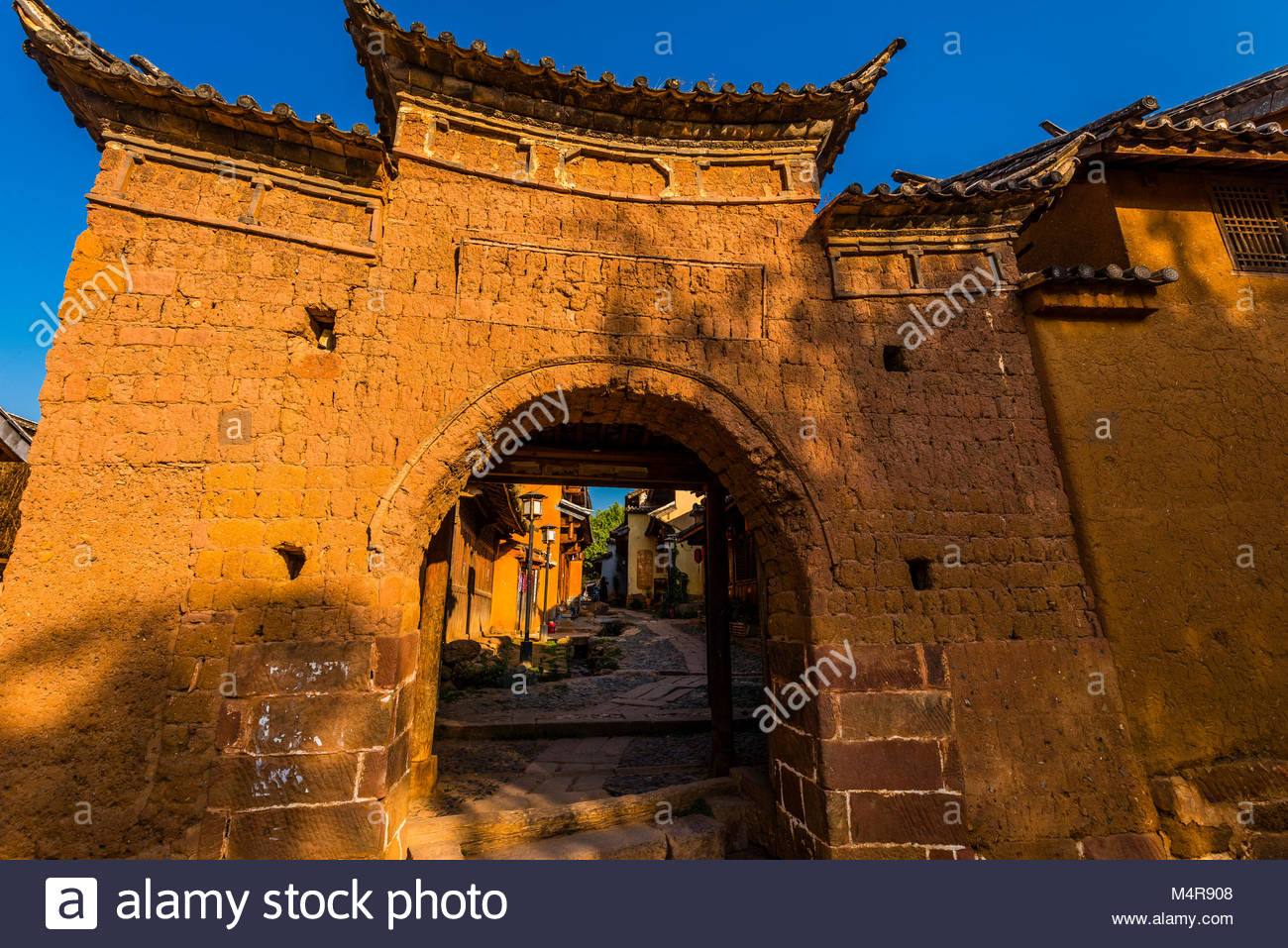 Back lanes with buildings made of mud brick (adobe) in the market town of Shaxi, on the Tea Horse Caravan Road, - Stock Image