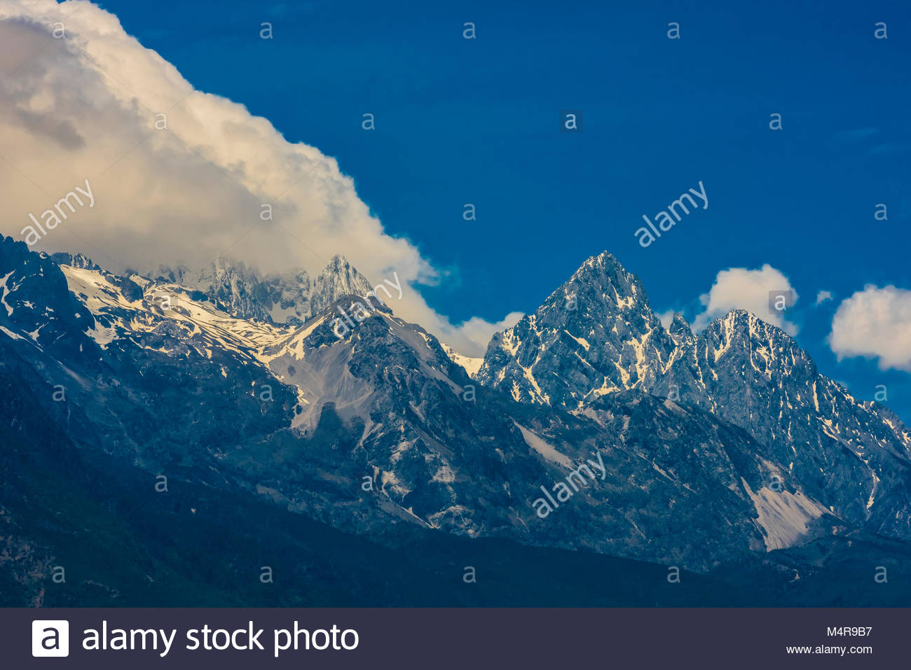 18,360 foot Jade Dragon Snow Mountain, Lijiang, Yunnan Province, China. - Stock Image
