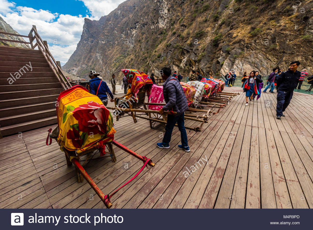 Sedan chairs used to carry tourists up the steep steps at the Tiger Leaping Gorge, on the road between Lijiang and - Stock Image