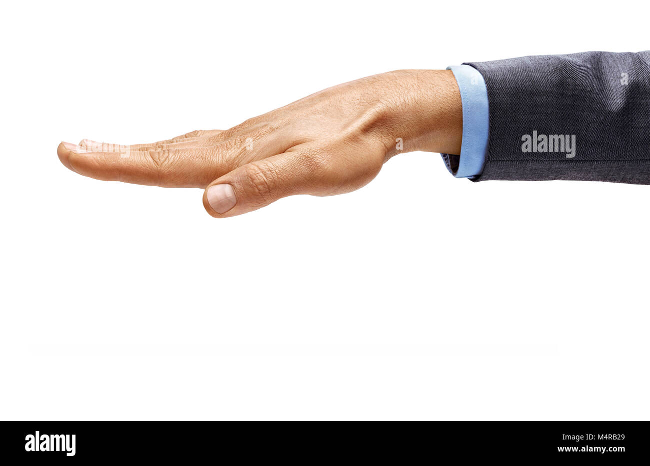 Man's hand in suit closes something isolated on white background. Close up. High resolution product - Stock Image