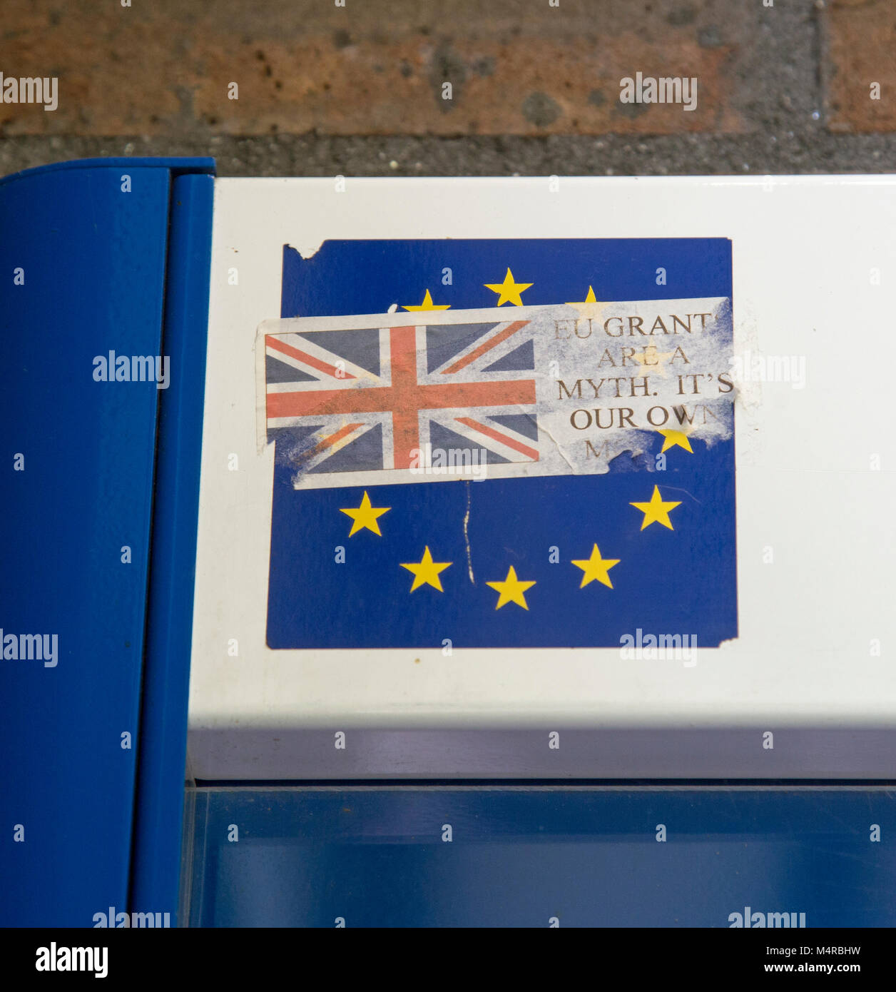 Bodmin, Cornwall, England, February 2018, A pro Brexit sticker on a European Union banner has been torn illustrating - Stock Image