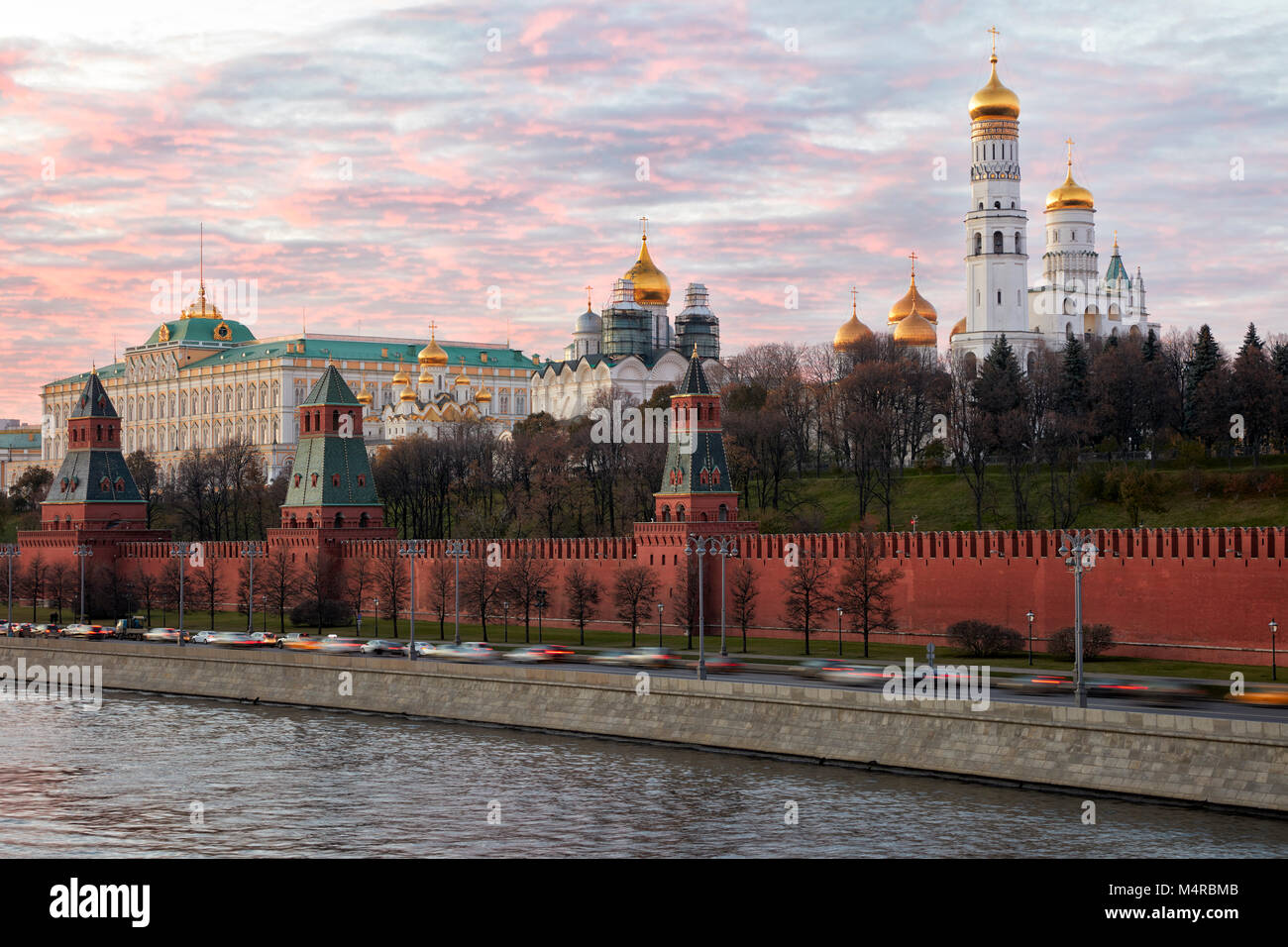 Kremlin cathedrals behind the southern part of the Kremlin Wall at dusk. Moscow, Russia. - Stock Image