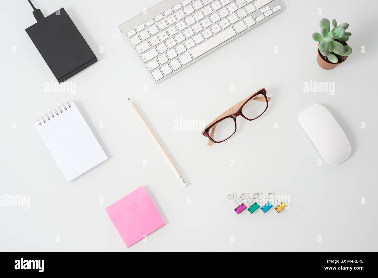 Modern office work desktop and sparse objects - Stock Image