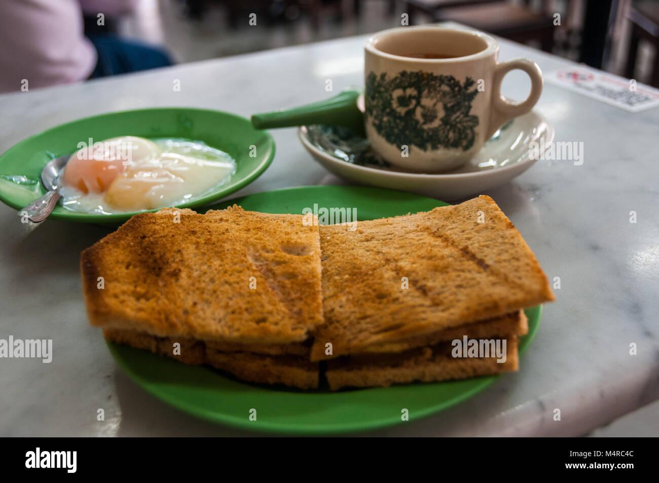 A breakfast kaya toast set from Ya Kun Kaya consisting of slices of kaya toast – bread with kaya jam – two kind - Stock Image