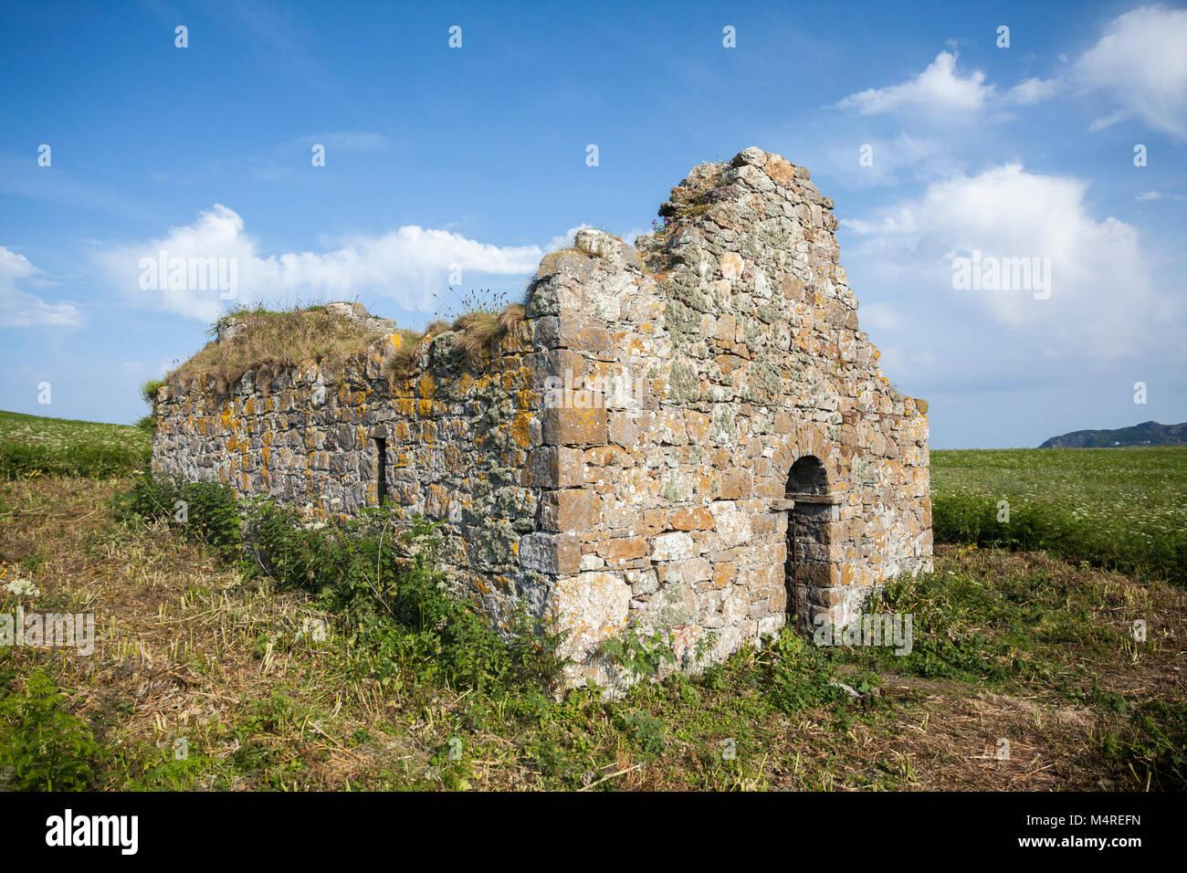 The ruins of St. Nessan's Church, Ireland's Eye, Howth Head, County Dublin, Ireland. - Stock Image