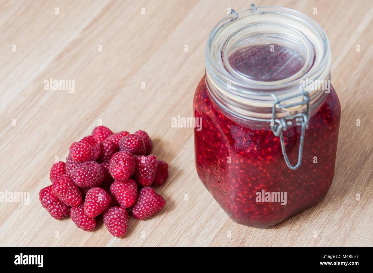 raspberry jam in jar isolated - Stock Image