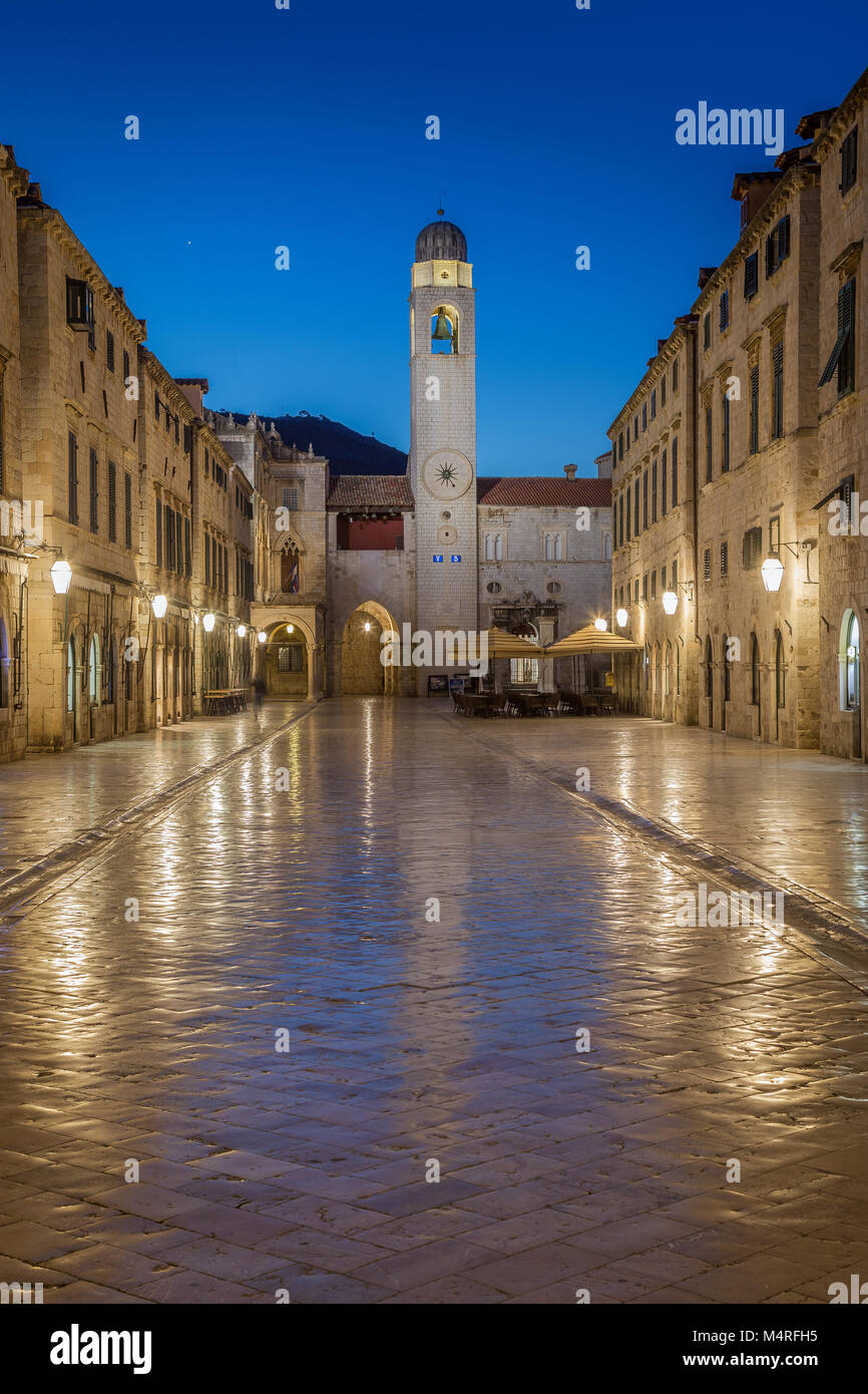 Classic panoramic view of famous Stradun, the main street of the old town of Dubrovnik, in beautiful morning twilight - Stock Image