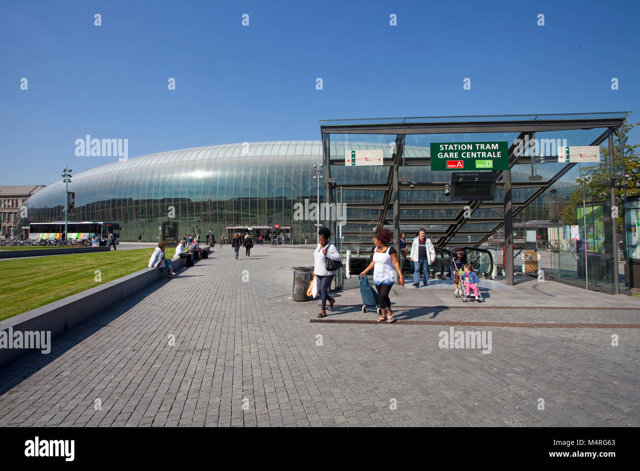 Travellers at train station, modern glass construction covers the old building of the 19th century, Strasbourg, - Stock Image
