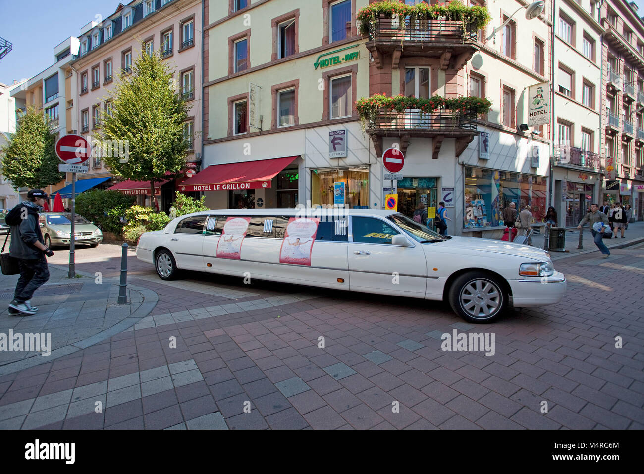 Stretched limousine turns to Rue du Maire Kuss, Strasbourg, Alsace, France, Bas-Rhin, Europe - Stock Image