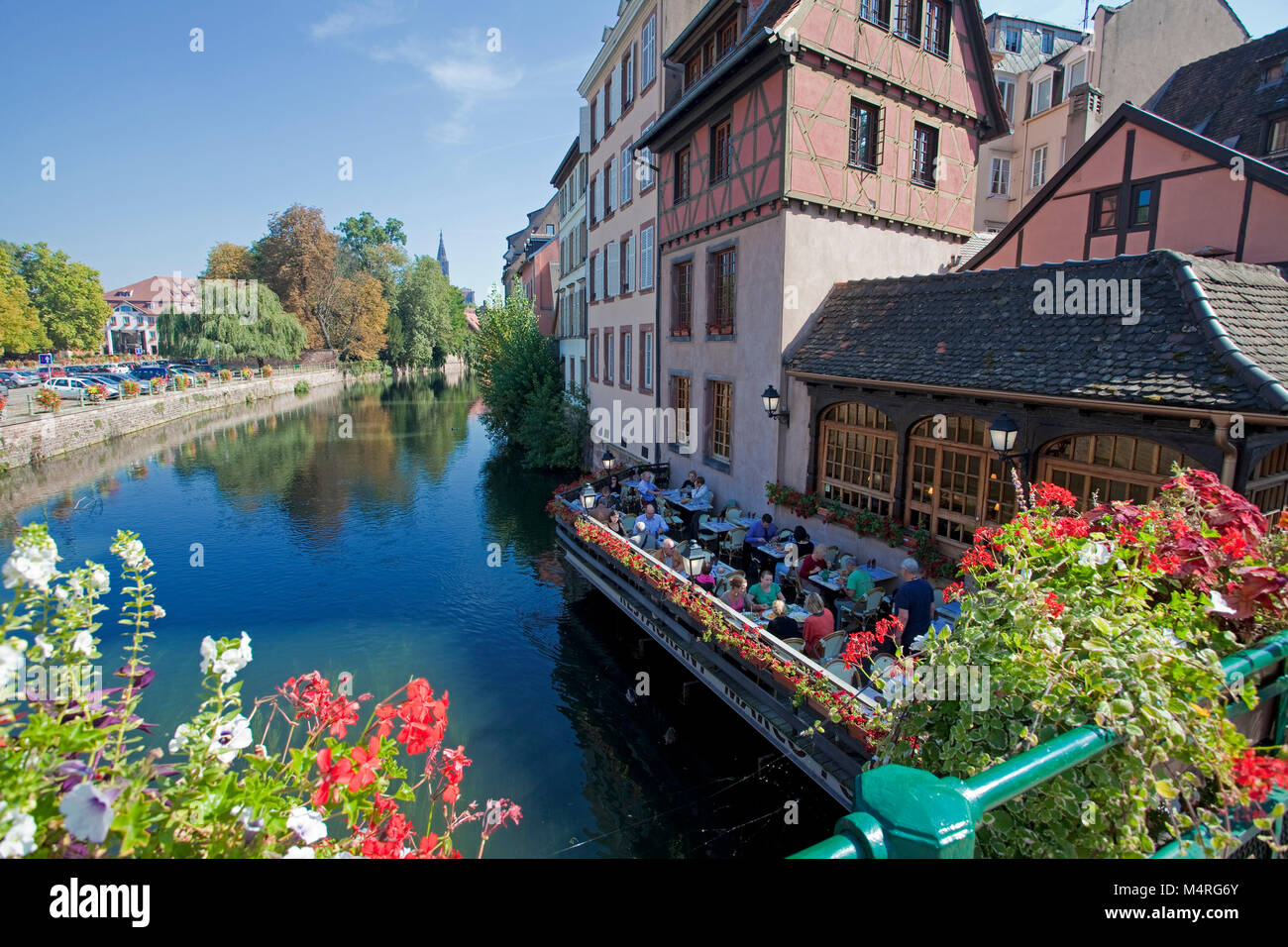 View from Pont Couvert to Ill iver and terrace of restaurant L' Ami Schutz, La Petite France (Little France), - Stock Image