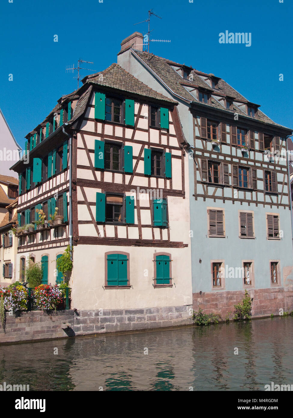 Half-timbered houses at Ill river, La Petite France (Little France), Strasbourg, Alsace, Bas-Rhin, France, Europe - Stock Image