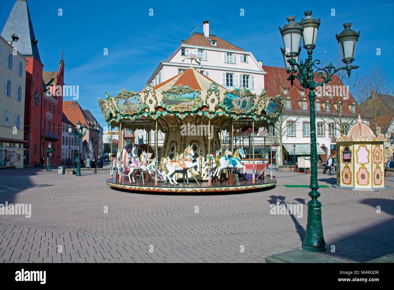 Old historical children's merry-go-round at Haguenau, Alsace, France, Europe Stock Photo