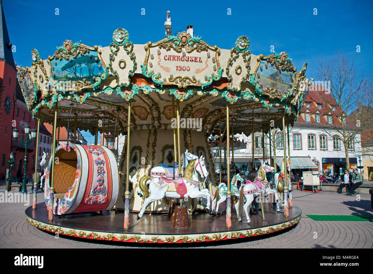 Old historical children's merry-go-round at Haguenau, Alsace, France, Europe - Stock Image