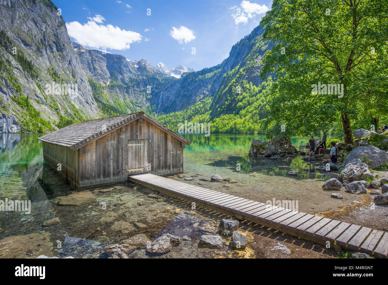 Traditional wooden boat house at the shores of famous Lake Obersee in Nationalpark Berchtesgadener Land on a sunny Stock Photo
