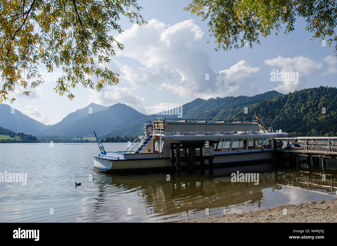At Schliersee, one can explore the lake from a boat, which is great fun in summer. - Stock Image
