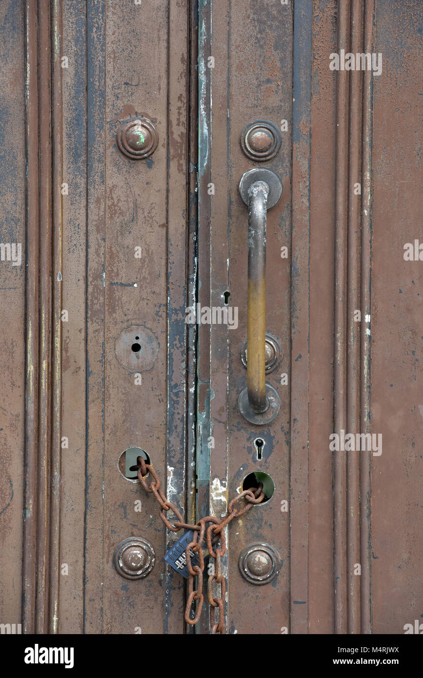 An Old Wooden Heavy Duty Strong And Secure Door Or Pair Of Doors With A  Padlock