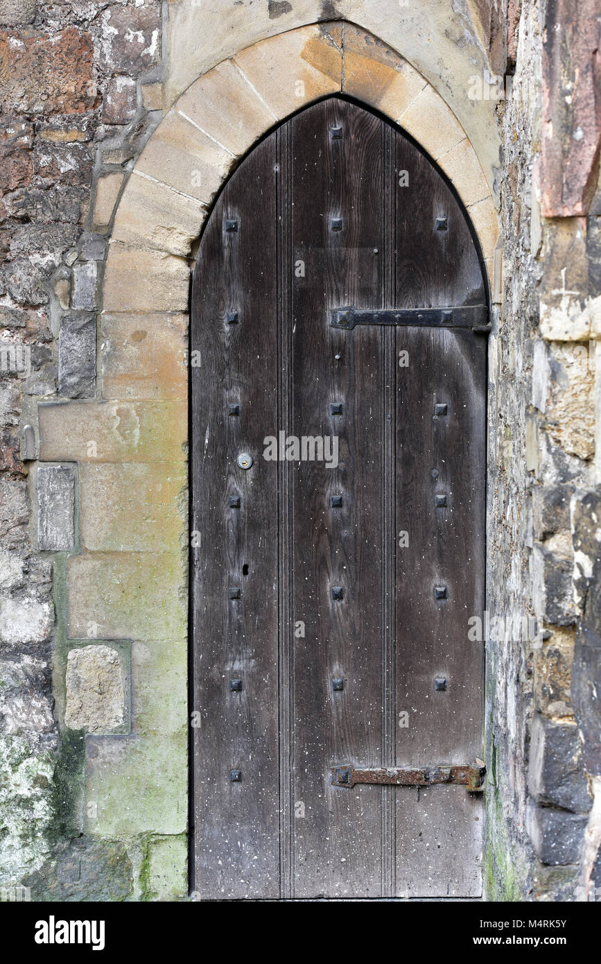 An old historic wooden castle or dungeon door in a stone wall made of thick wood & Castle Dungeon Door Stock Photos u0026 Castle Dungeon Door Stock Images ...