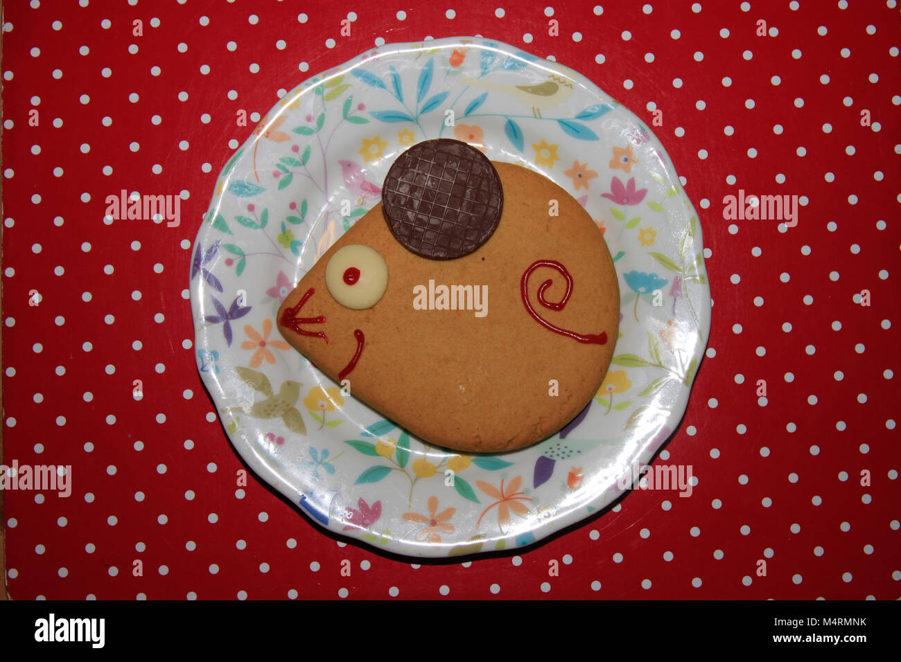 Decorated Festive Shortbread Biscuits On Tea Plates On Red Spotty