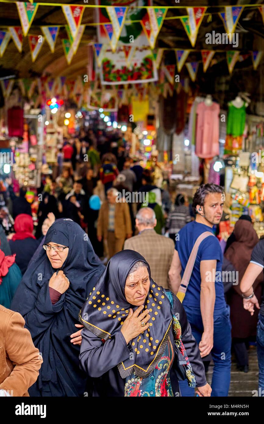 Tehran, Iran - April 29, 2017: Muslim women in hijabs in the big market. - Stock Image