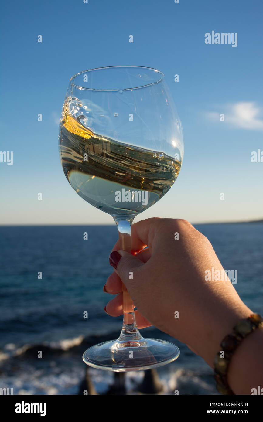 Tasting Of Glass Of Cold White Wine Served On Outdoor