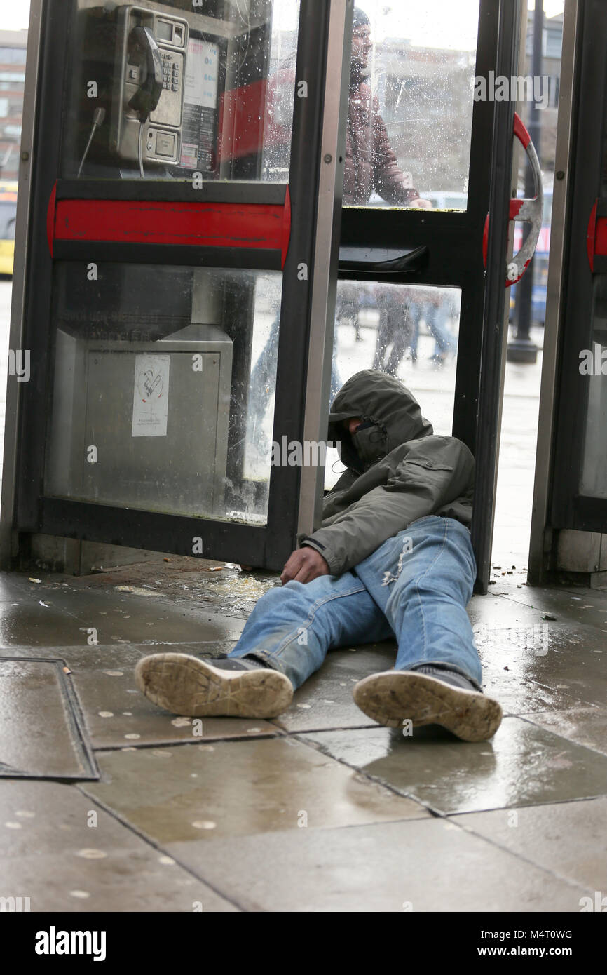Manchester, UK. 17th Feb, 2018. Homelessness has increased due to housing costs. A homeless man lying in his own - Stock Image