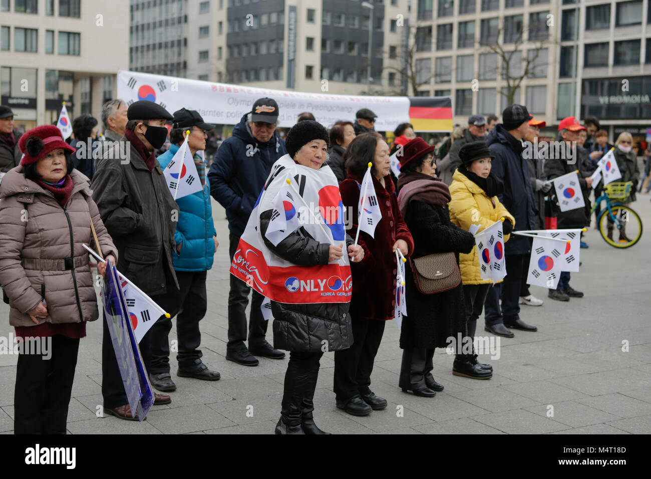 Frankfurt, Germany. 17th February 2018. People are pictured at the rally, holding South Korean flags. South Koreans Stock Photo