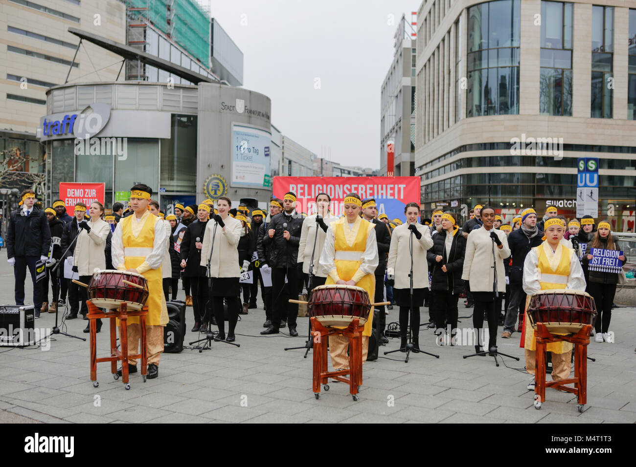 Frankfurt, Germany. 17th February 2018. Sympathisers of the Human Rights Association for Forced Conversion sing Stock Photo