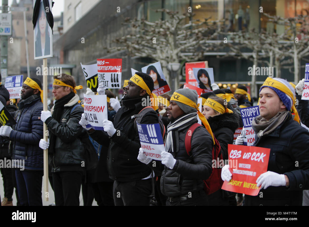 Frankfurt, Germany. 17th February 2018. Sympathisers of the Human Rights Association for Forced holds up signs that Stock Photo