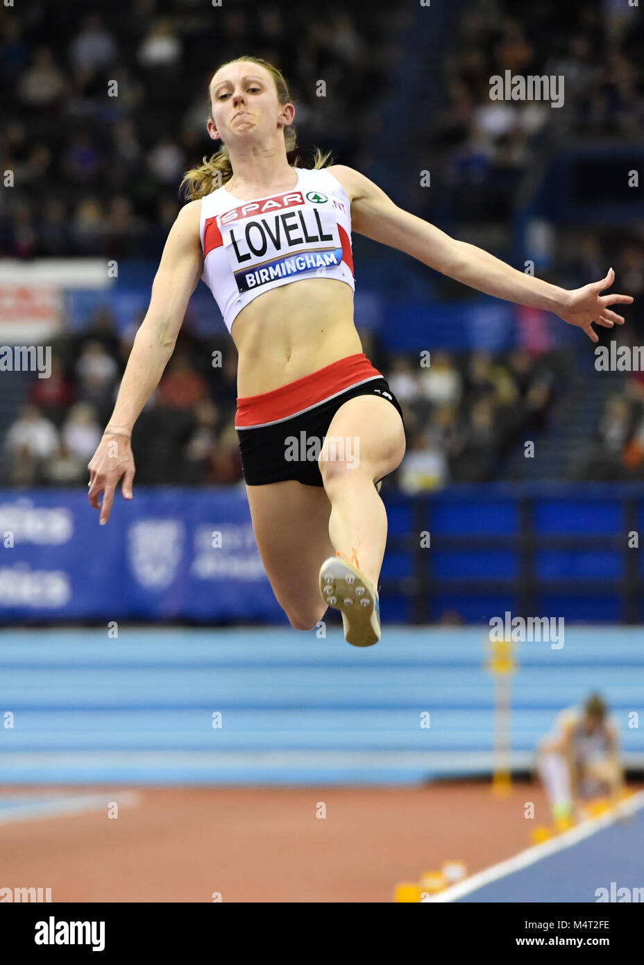 Elise Lovell in action during today's Women's High Jump  during SPAR British Athletics Indoor Championships - Stock Image